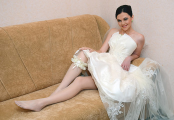 beautiful bride with garter on leg
