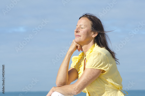 Relaxed meditating woman outdoor