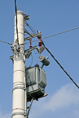 electricity transformer mounted on a pole for electric current