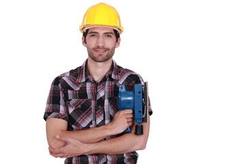 Carpenter posing with power sander