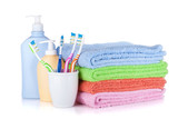 Toothbrushes, shampoo bottles and colored towels