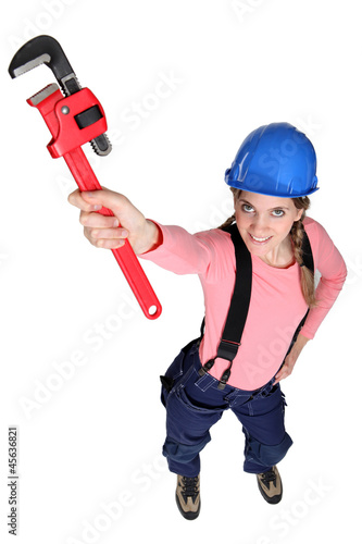 Female plulmber holding wrench