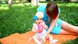 Mother and her cute baby girl play outdoor
