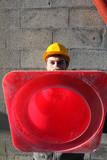 Builder holding traffic cone