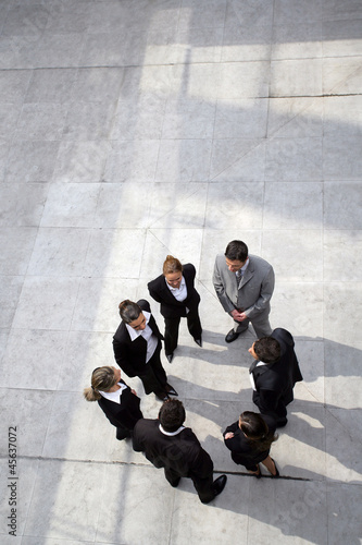 Business team stood in a circle