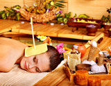 Woman getting massage with ear candle .