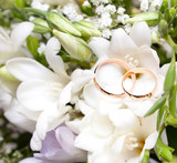 Gold wedding rings on flower