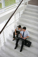 Business people on a stairwell