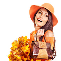 Woman holding  orange handbag.