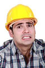 Portrait of scared laborer