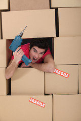 Man with hole surrounded by cardboard