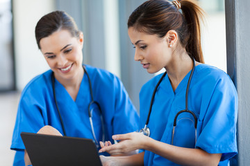 two beautiful female healthcare workers using laptop