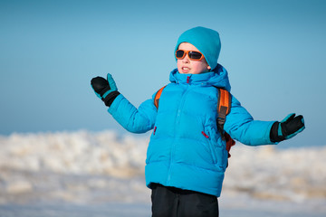 Cute little boy outdoors on cold winter day