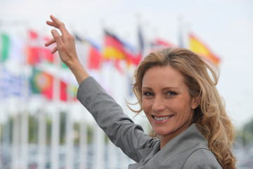 Woman pointing at flags