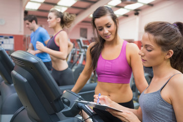 Female gym instructor and woman