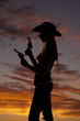 woman with two guns silhouette