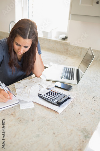Woman calculating finances