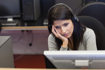 Bored woman in computer room