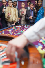 People looking at the roulette wheel
