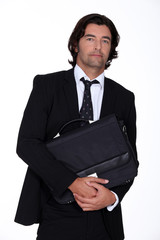 Businessman holding briefcase
