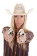 cowgirl points two pistols