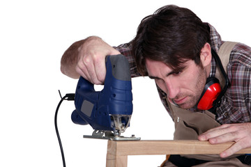 Carpenter using a jigsaw
