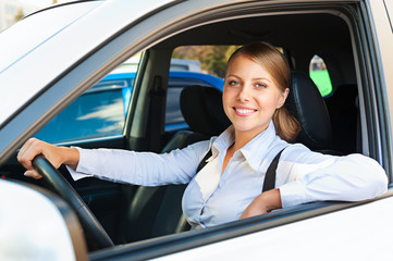 woman sitting in the car and smiling