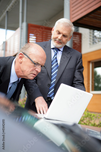 Two senior businessmen on a sales call