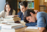 Student sleeping at study table