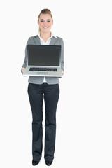 Businesswoman presenting a laptop