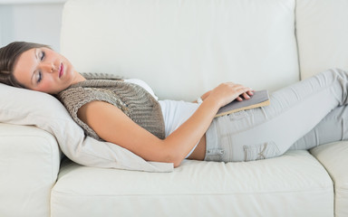 Woman lying on sofa and sleeping
