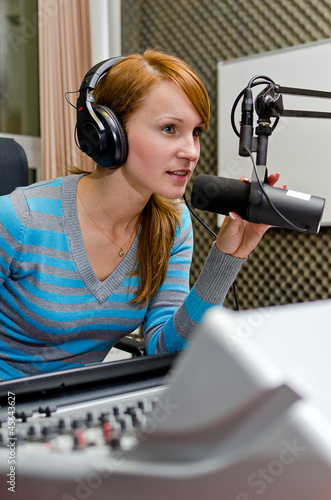 Female dj working on the radio
