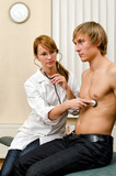 Young female doctor examine male patient with stethoscope