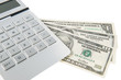 Taschenrechner und Amerikanische Dollar Banknoten