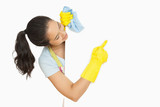 Happy woman pointing to white surface she is cleaning