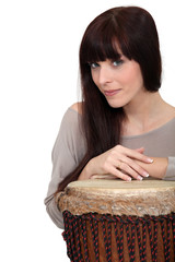 Woman posing with bongo drum