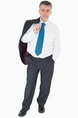 Businessman holding jacket on his shoulder