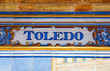 Toledo sign over a mosaic wall