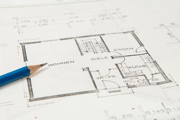 Bauplan Einfamilienhaus mit Bleistift