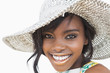Woman wearing summer hat smiling