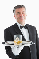 Man serving whiskey on toy
