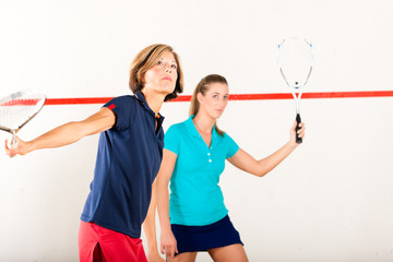 Squash racket sport in gym, women competition