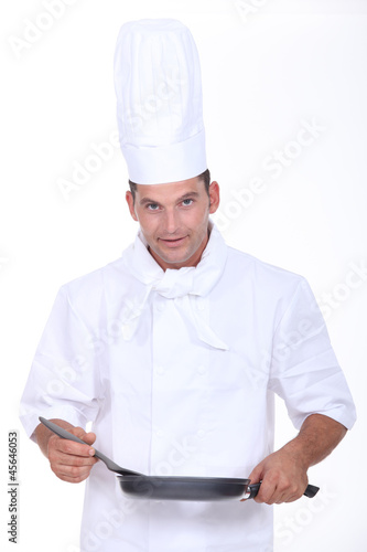 Chef stirring sauce