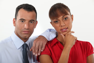 young businessman and businesswoman posing together