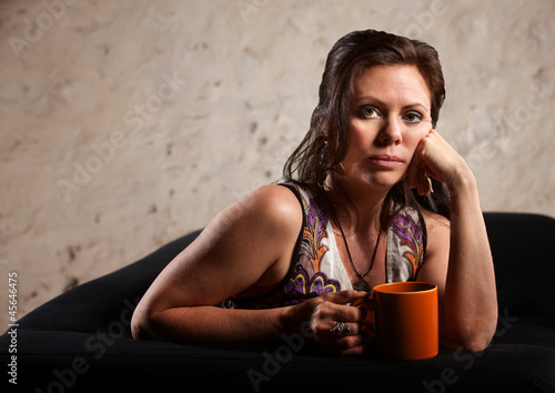 Serious Woman with Hand on Cheek