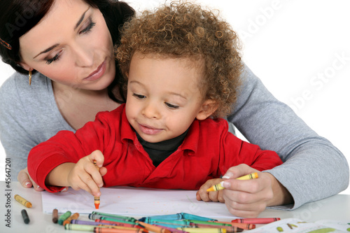 Mother sat with boy drawing