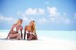 girls sitting on ocean coast