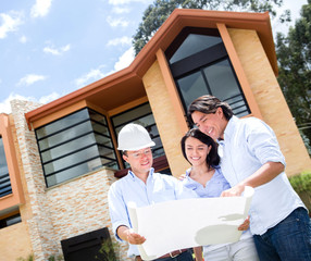 Couple talking to architect about a house