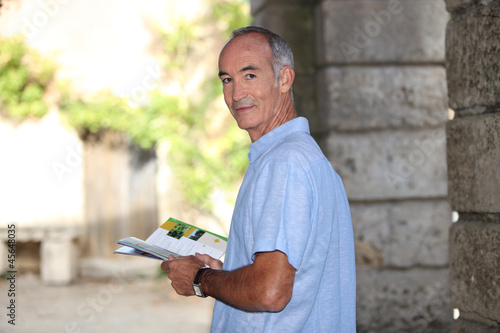A tourist reading a guide