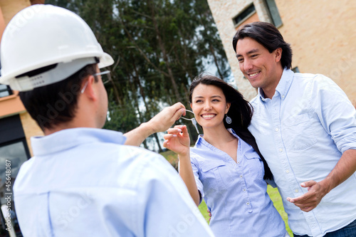 Couple getting keys of new house